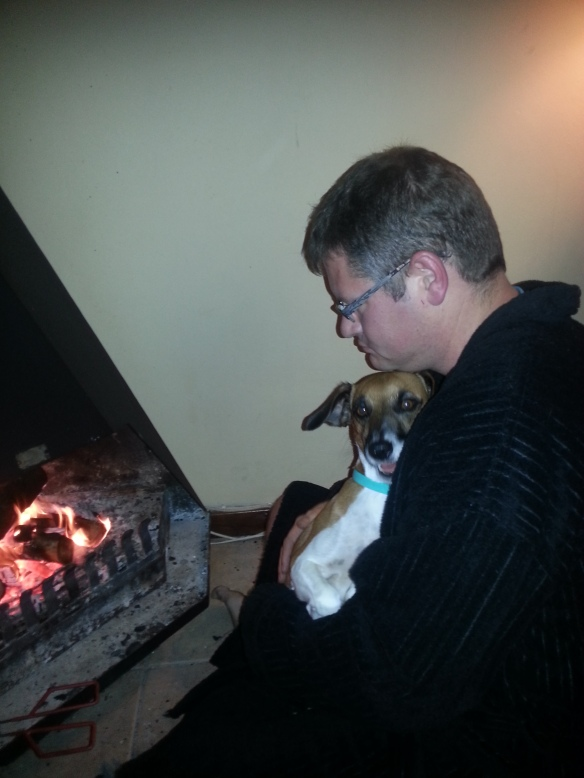 Bertie loves the fireplace and sitting with his dad. Best of both!