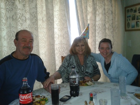 Family shot of the birthday meal - with hatted birthday girl