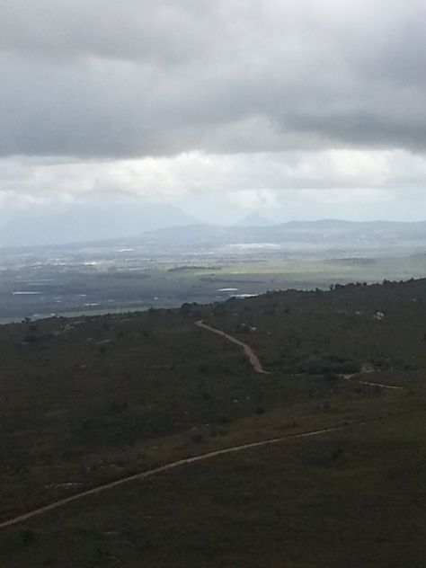 Not such a great shot but it shows the 8km of dirt road we travelled up to reach the start of the climb up Paarl Rock - entry is R32 per vehicle and R8 per person