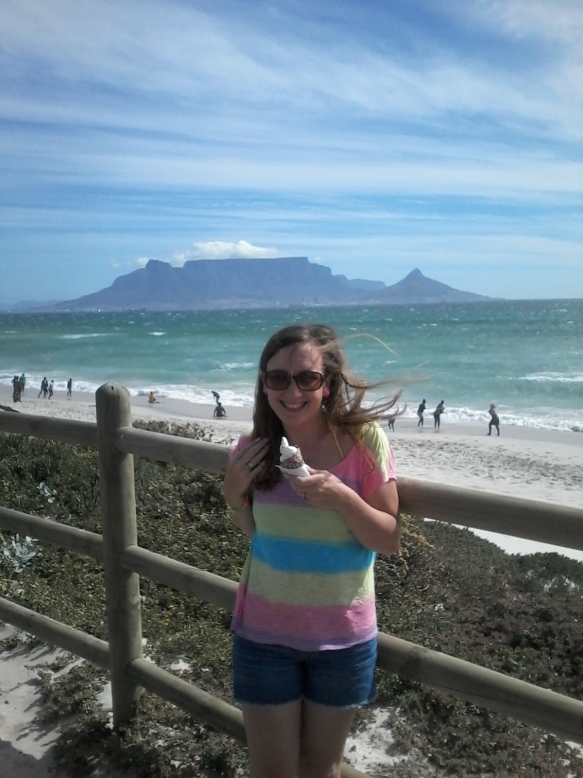 Hair blowing in the breeze as I enjoy an ice cream on the beach