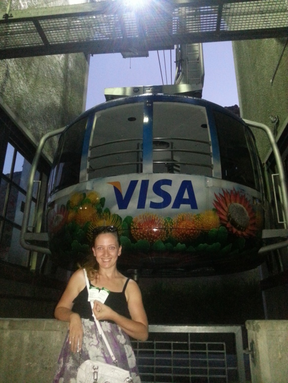 Me in front of the cable car with our 'golden tickets' (Mine had 'Happy birthday Leigh' printed on it, and the ticked issuer sang to me)
