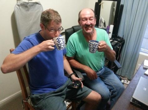 Dad and boy enjoying their coffees