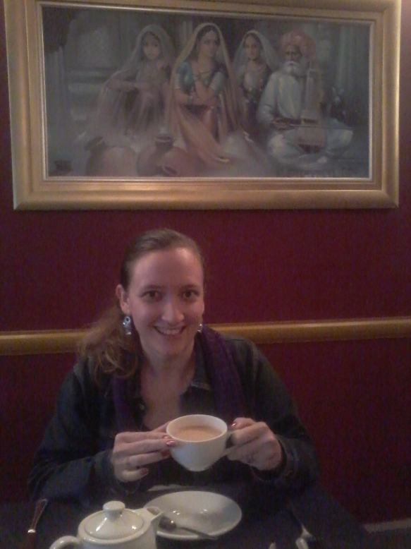 Enjoying my masala chai... and the painting behind me
