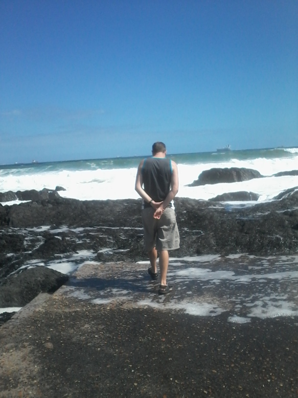 Ahoy me mateys, it's high tide! Walking along the wet rocks at the crashing waves in front of Petit Fours in Blouberg