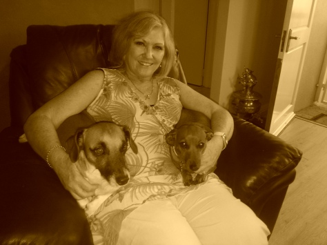 Doggies with their granny, in sepia