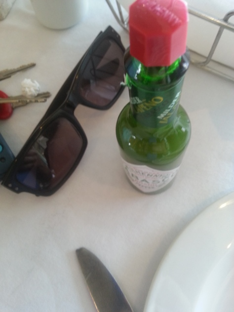Breakfast essentials - sunnies and tabasco sauce - though the red bottle is preferable to the green