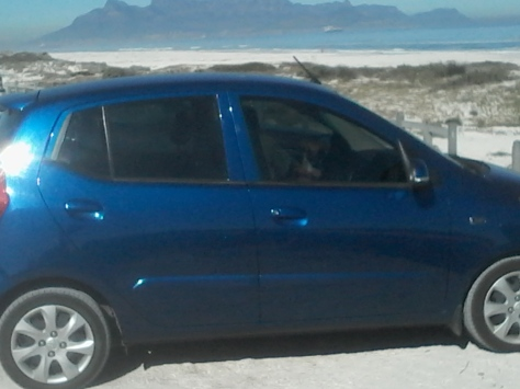 Bertie (in the car with his dad) SO excited for his walk along the beach at Kreeftebaai