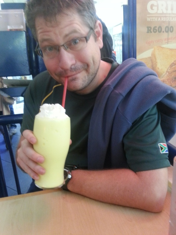 Husband having a much-needed banana milkshake (large) at Wimpy Bayside later that day