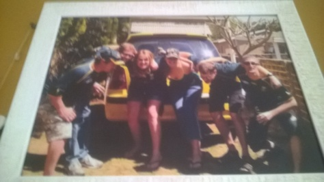 It's the framed photo our besties presented us with before we moved to Cape Town, showing all of us in our Springbok supporters gear.