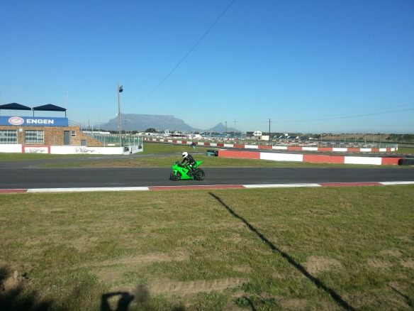 Watching the bikes zoom around the track at Killarney - this greenie was the winner of the race we watched