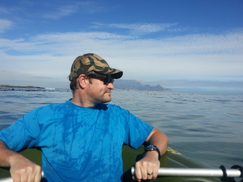 Rowing us out into the deep blue (grey) sea! Note how wet his shirt is, and also dimple that only shows when Very Happy