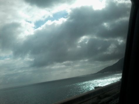 Grey skies and silver seas near Camps Bay as seen in the car on the way home