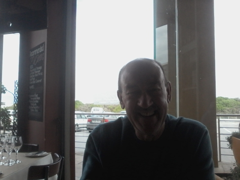 My sweet smiley dad waiting for his half-price half-half topping pizza to arrive