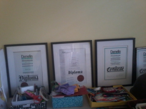 A selection of the Husband's framed certificates, diplomas, etcetera etcetera.
