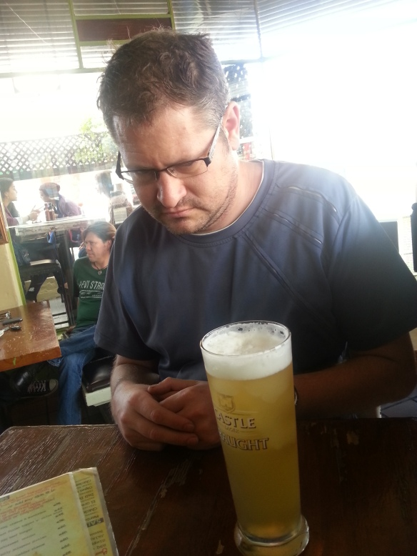 Suspiciously contemplating his Iceberg at the Fat Cactus - a Castle draught topped with floaty frozen lime margerita