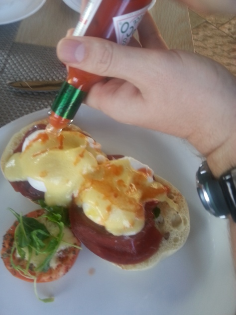 You can tell who ordered this by the fact that it's being thoroughly Tabasco sauced. He flipped a coin and decided on the springbok carpaccio version of eggs bennie