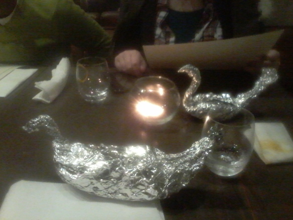 See how much more 'swan-like' the silver (leftover food-filled) swan  at the other end of the table looks than mine?