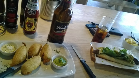 The is what we ate - mini boerie poppers with various dippy sauces, and the Mexican Boerie with guacomole and  skinny fries. Black Label bottle is just serving as table decoration