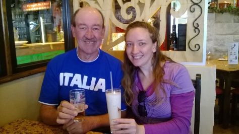 Dad and me displaying our drinks at Petiscos