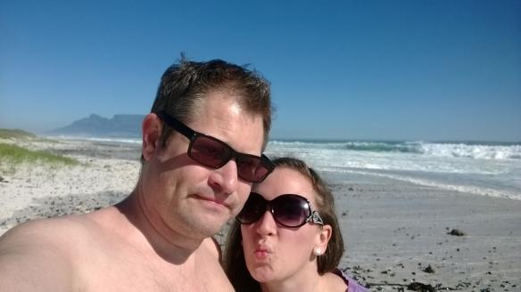 Pre-anniversary kisses on the beach