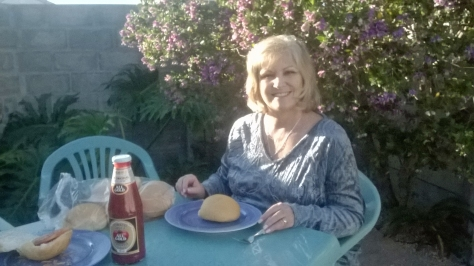 Then we drove back home for lupper at the parents. Here's Mum sitting at their pretty new summer blue (it's teal, really) garden table  by the purple tree