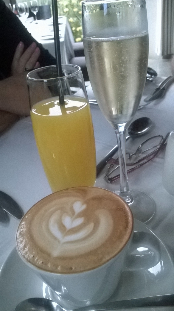 Delightful array of breakfast drinks - cappuccino (mine), orange juice (mom's), glass of bubbly (dad's)