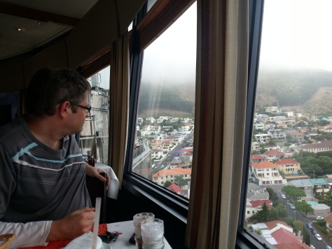 Husband admiring the view. This is about 10 minutes after we were seated, as our table was originally behind the side building you can see behind Husband outside the window
