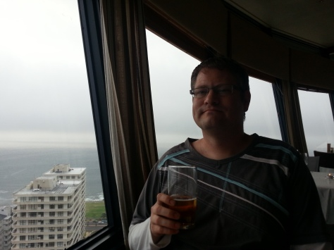 Husband looking mightily pleased with himself - we were on the 24th floor, which made the cars and people below look like toys