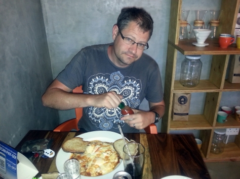 We awoke bright and early on our last day of leave and headed to Reload in Parklands for a spot of brekkie. Here is Husband about to douse his Turkish omelette in Tabasco sauce