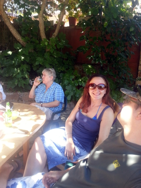Mother surreptitiously sipping her wine, Husband and I happy in the sunshine