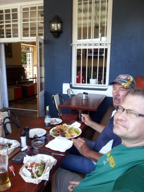 Dad and Husband tucking in on the other side of table.