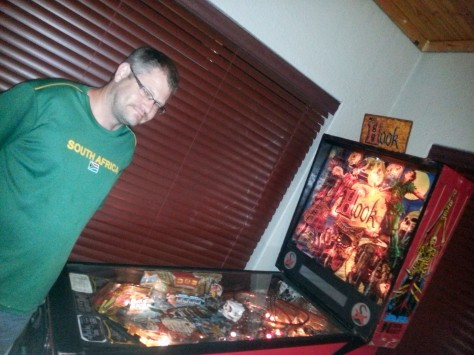 Husband admiring Jana's Husband's pinball machine, which had been lovingly restored