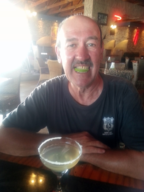 Dad demonstrating the slice of lime that adorned his margerita glass