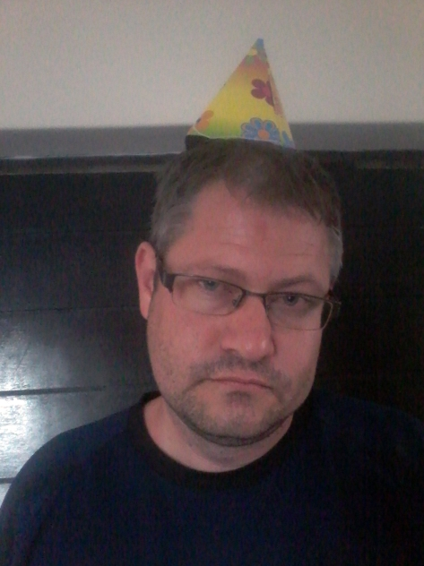 When we got home, I made Husband wear the birthday hat. He's not exactly thrilled here...