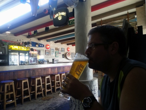 Husband having a draught at the Boardhouse on the beachfront