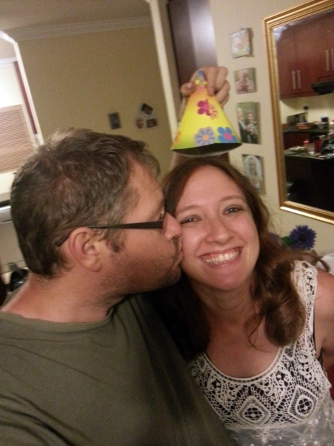 The standard Andrews family  'wearing a birthday hat and getting a birthday kiss on the cheek photo