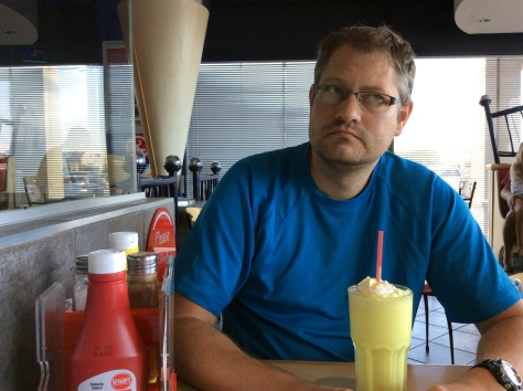 Contemplating his Saturday banana milkshake (large) at our closest Wimpy.