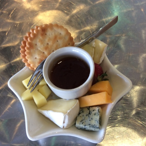 Amazing individual cheeseplate with a pot of something figgy to dip it in