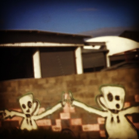 I know it's a bit blurry but I've been meaning to get a shot of this graffiti since I first noticed it, in the MyCiti bus lane between the Paarden Eiland and Neptune stops. Don't they look like happy ghosties high-fiving?