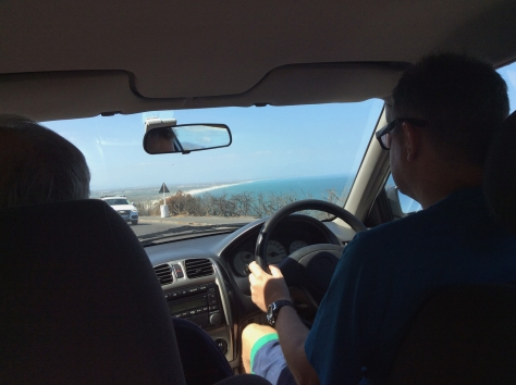 Husband driving us home, past Muizenberg's bright blue sea