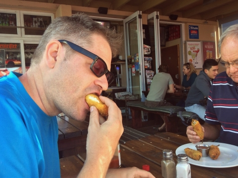 Husband showing his dubious dad how you eat the bacon-and-feta-filled jalapeno poppers at Ilha