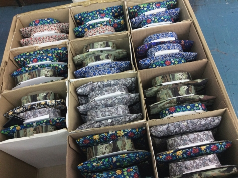 All the pretty shirts precisely sewn, buttoned, steamed, packaged and ready for distribution.