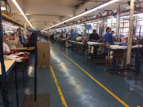 Have you ever actually been inside a clothing factory? It's fascinating to see exactly how seemingly simple items are put together. Row and rows and rows of machinists at work