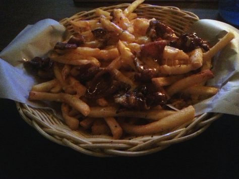 My bacon cheese fries. An enormous portion, and the bacon had a sweet marinade of sorts. Actually couldn't finish, even with Husband's help. Gave my doggy box to the car guard.