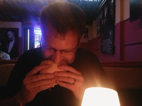 Husband tucking into the Man vs Food 'from hell' supposedly hot burger. He raised an eyebrow and wolfed it down.