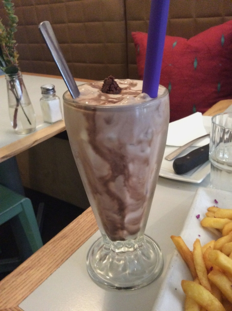 And there was this - a fudgey brownie milkshake, with chunks of  chocolate brownie in the bottom of the glass - and by chance, a purple straw.