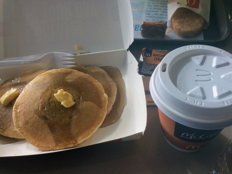 Inexpensive yet filling breakfast from McDonald's - the hot cakes (I always want to ask if they sell like hot cakes, har har) with the coffee that came as part of Husband's McMuffin meal.