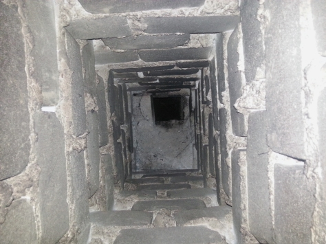 Our deep, dark chimney, as seen from above when Husband went looking for a blockage of sorts in it last Friday, while I was merrily a-blogging my last update to you all...