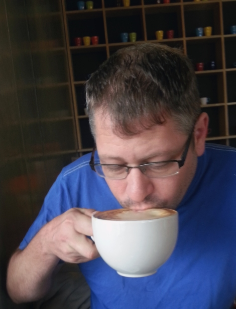 A sight you don't see everyday - Husband having not just a coffee for breakfast, but a triple cappuccino at Reload. It was good.