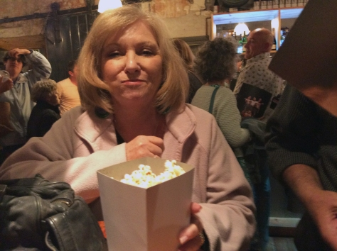 Mom enjoying the popcorn at half-time. Such a treat!